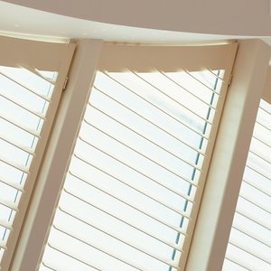 white-wood-conservatory-shutters