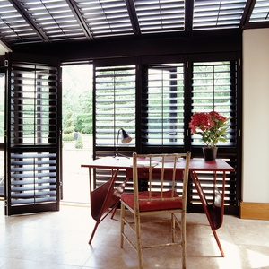 New England painted black conservatory shutters