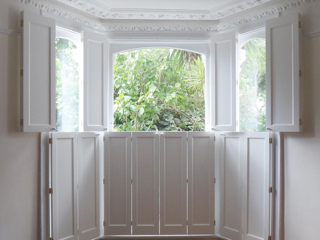 Handcrafted solid wooden shutters tnesc london - Solid panel interior window shutters ...