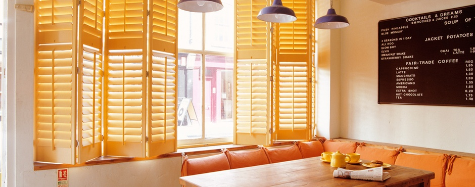 Tnesc New England painted full height London Cafe shutters