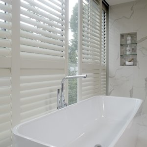 white-bathroom-sliding-shutters