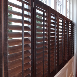 Bespoke shutters in a distressed faux leather finish