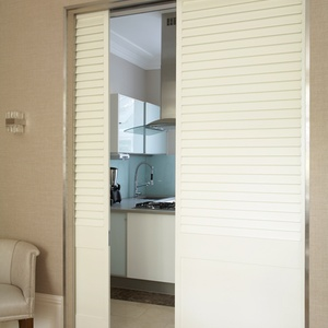 Solid fixed louvre shutters, room divider