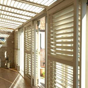 Tnesc Manhattan shutters painted Full Height Conservatory Bi pass sliding tracks