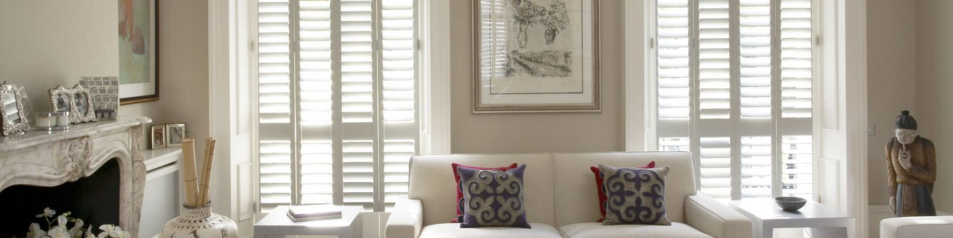 white-painted-wood-shutters