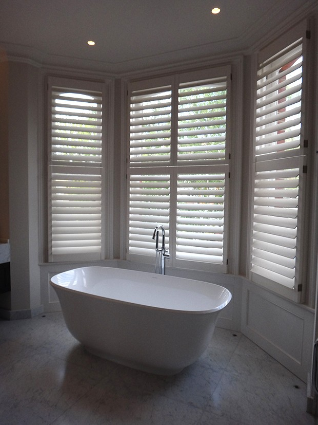 Manhattan shutters in bathroom designed by Oliver Bea Interior Design