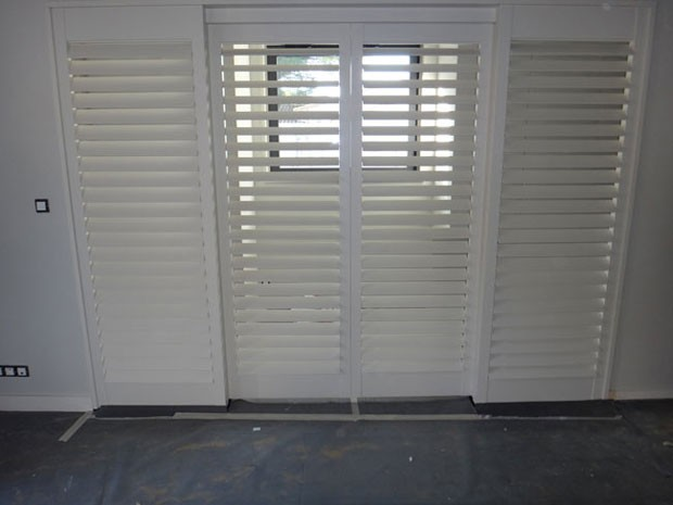 White painted tulipwood shutters