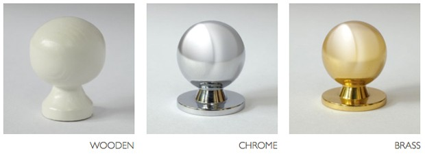 Wooden, chrome and brass door knobs